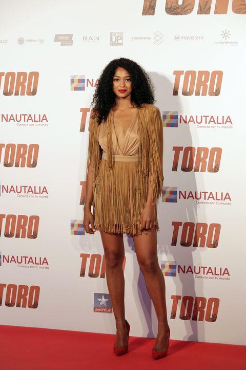 Brown, Dress, Shoe, Human leg, Flooring, Style, Carpet, Fashion model, Waist, Thigh,