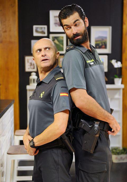 Shoulder, Uniform, Beard, Police, Facial hair, Law enforcement, Belt, Police officer, Security, Official,