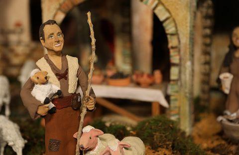 Nativity scene, Figurine, Interior design, Plant, Toy, Tradition, Smile,