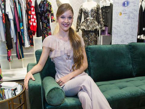 Green, Sitting, Pink, Fashion, Room, Leg, Fashion design, Furniture, Jeans, Textile,
