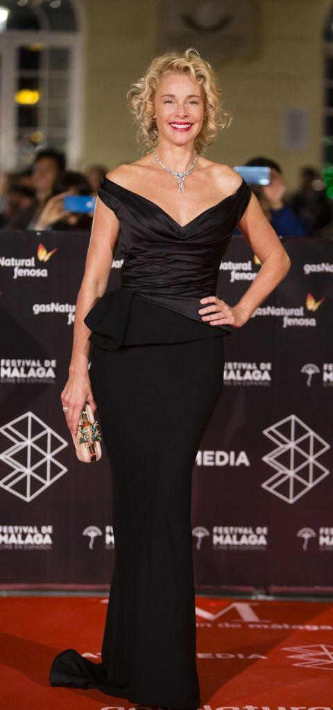 Dress, Clothing, Shoulder, Carpet, Premiere, Red carpet, Hairstyle, Fashion model, Little black dress, Fashion,