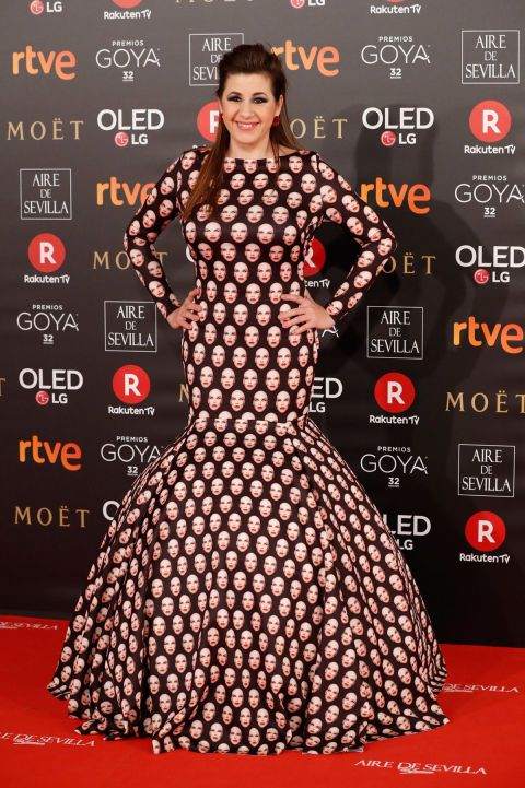 Red carpet, Carpet, Clothing, Dress, Premiere, Flooring, Polka dot, Pattern, Gown, Event,