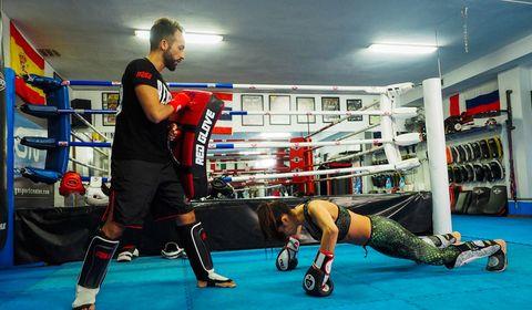 Sport venue, Human leg, Room, Boxing equipment, Boxing, Contact sport, Sports gear, Combat sport, Striking combat sports, Sports,