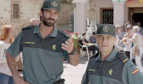 Arm, Cap, Sleeve, Uniform, Headgear, Elbow, Logo, Baseball cap, Law enforcement, Polo shirt,