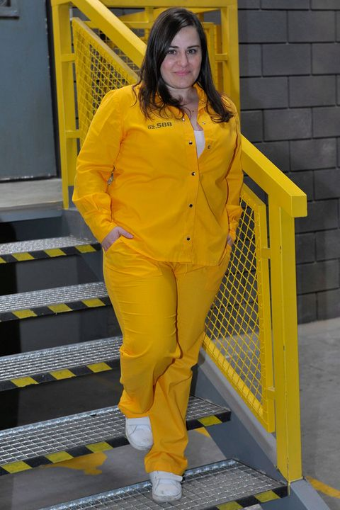 Yellow, Sleeve, Standing, Style, Street fashion, Fashion, Orange, Long hair, Top, Fashion design,