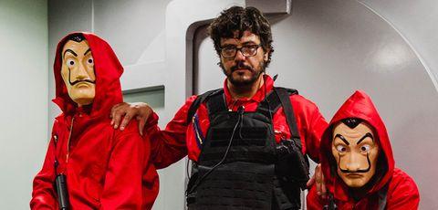 Red, Outerwear, Human, Jacket, Team, Costume, Hoodie,