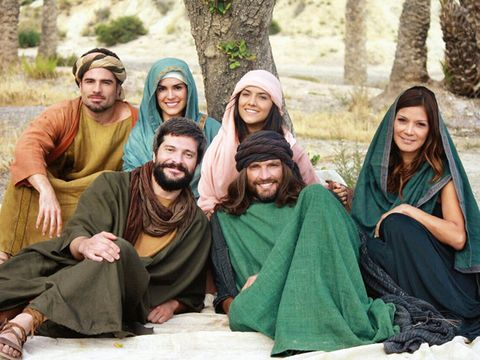 Face, Smile, People, Social group, Sitting, Facial hair, Community, People in nature, Beard, Temple,