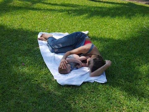 Grass, Comfort, Elbow, Nap, Lawn, Knee, Grass family, Sleep, Groundcover, Love,