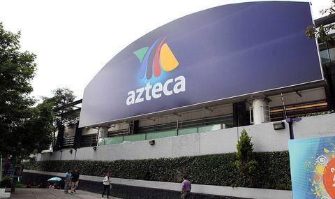 Commercial building, Logo, Sidewalk, Urban design, Signage, Pedestrian, Advertising, Company, Brand, Headquarters,