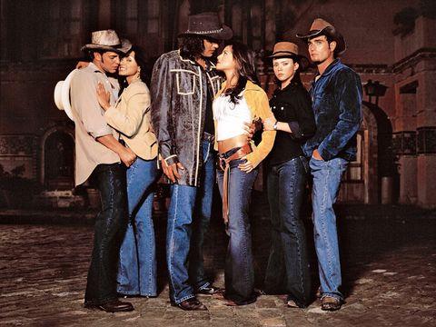 Trousers, Denim, Jeans, Social group, Hat, Shirt, Textile, Jacket, Interaction, Headgear,