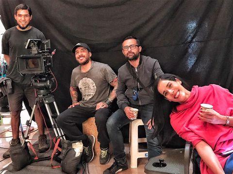 Face, Sitting, Film camera, Beard, Facial hair, Filmmaking, Camera operator, Cinematographer, Camera, Cameras & optics,