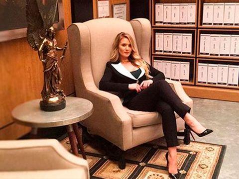 Sitting, Leg, Furniture, Footwear, Blond, Chair, Interior design, Shoe, Long hair, Leggings,