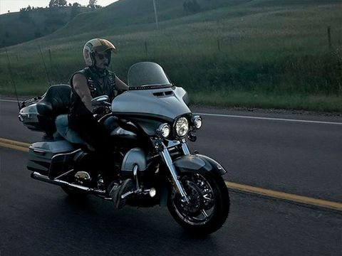Motorcycle, Motor vehicle, Mode of transport, Automotive design, Motorcycle helmet, Road, Automotive tire, Automotive mirror, Helmet, Infrastructure,