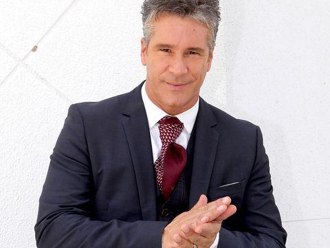 Suit, White-collar worker, Formal wear, Businessperson, Blazer, Business, Gesture, Tuxedo, Tie, Outerwear,