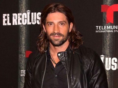 Facial hair, Hair, Beard, Leather, Moustache, Jacket, Leather jacket, Textile, Long hair, Fictional character,
