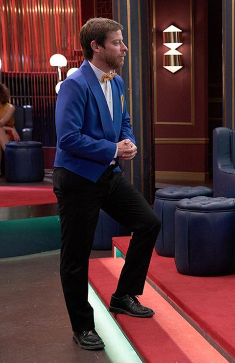 Suit, Formal wear, Footwear, Games, Event, Recreation, Carpet, Electric blue, Shoe, Flooring,