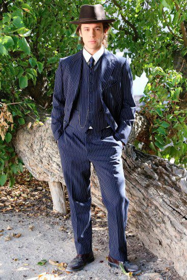 Clothing, Hat, Dress shirt, Collar, Sleeve, Trousers, Shirt, Outerwear, Formal wear, Coat,