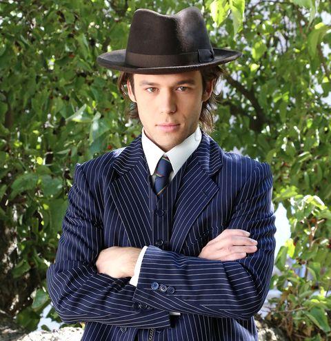 Clothing, Hat, Dress shirt, Collar, Sleeve, Shirt, Outerwear, Formal wear, Style, Headgear,