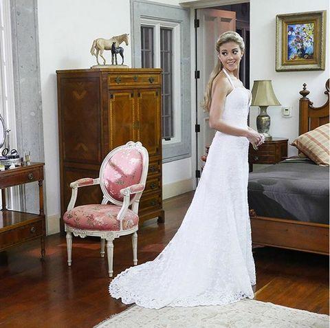 Room, Wood, Dress, Floor, Shoulder, Flooring, Textile, Furniture, Photograph, Bridal clothing,