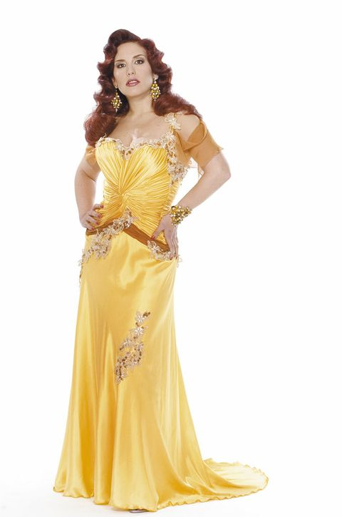 Clothing, Fashion model, Dress, Gown, Shoulder, Yellow, Formal wear, Joint, Haute couture, Bridal party dress,