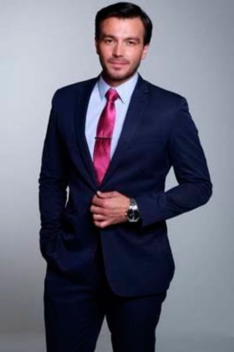 Suit, Clothing, Formal wear, Blazer, Outerwear, Tuxedo, White-collar worker, Jacket, Businessperson, Tie,