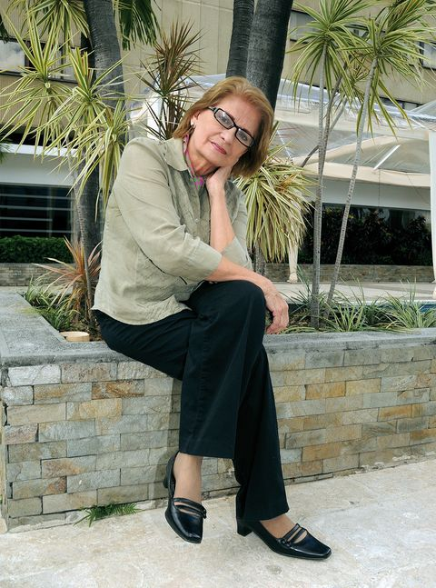Photograph, Sitting, Beauty, Fashion, Street fashion, Footwear, Botany, Leg, Shoulder, Photo shoot,