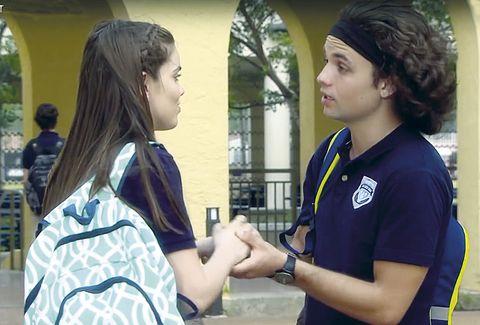 Arm, Sleeve, Wrist, Interaction, Youth, Gesture, Conversation, Watch, Bracelet, Long hair,