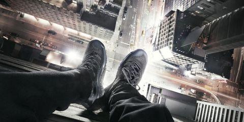 Human leg, Metropolitan area, Metropolis, Cityscape, Tower block, Leather, Commercial building, Skyscraper, Boot, Walking shoe,