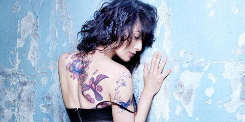 Hairstyle, Shoulder, Joint, Tattoo, Elbow, Black hair, Youth, Back, Chest, Long hair,