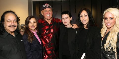 Dennis Hof surrounded by friends Ron Jeremy, Judith Regan, Heidi Fleiss, and others.