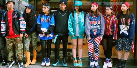 Footwear, Shirt, Outerwear, Jacket, Shorts, Headgear, Fashion, Street fashion, Team, Baseball cap,