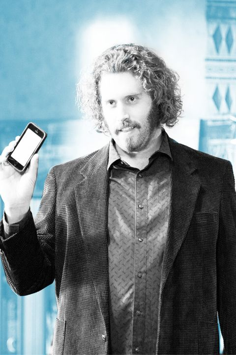 Dress shirt, Collar, Mobile phone, Facial hair, Standing, Communication Device, Portable communications device, Style, Gadget, Formal wear,