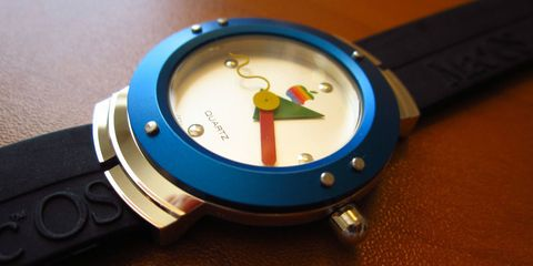 Product, Watch, Analog watch, Watch accessory, Glass, Font, Everyday carry, Azure, Metal, Brand,