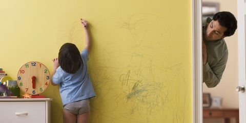 kid drawing with crayon