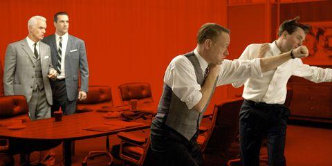 Coat, Furniture, Suit, Table, Formal wear, Chair, Suit trousers, Blazer, Tie, Conversation,