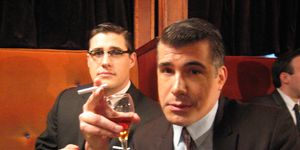 """<p>This photo, snapped during the filming of Mad Men's pilot, features a prop that wouldn't haunt Bryan Batt. """"Notice the cherry in Sal's drink,"""" he tells Esquire. """"Alan [Taylor] liked when I made a bit out of popping the cherry in my mouth on my line. That scene had numerous set ups and endless takes. I must have eaten 3 dozen cherries. Note to self: if possible avoid eating anything while filming. Rich [Sommer, seen here] later learned that lesson with donuts in Season 2.""""</p>"""
