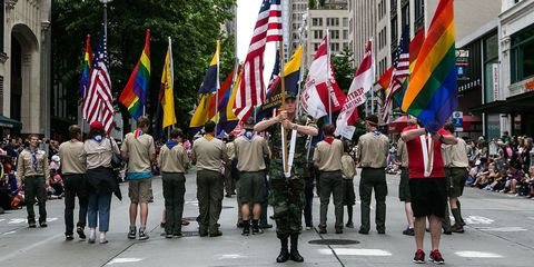 Footwear, Flag, Parade, Pole, Pedestrian, Backpack, Crew, Festival,