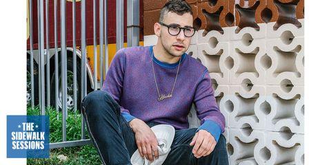 Eyewear, Vision care, Glasses, Sitting, Denim, Jeans, Majorelle blue, Street fashion, Sweater, Lap,