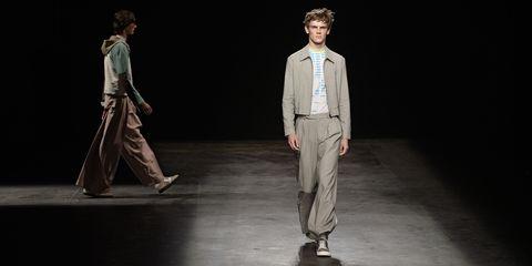 Suit trousers, Collar, Dress shirt, Standing, Formal wear, Blazer, Fashion, Stage, Pocket, Drama,
