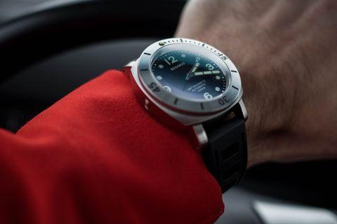 Watch, Wrist, Watch accessory, Fashion accessory, Analog watch, Carmine, Metal, Everyday carry, Brand, Clock,