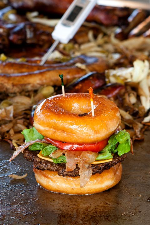 """Also known as the Luther Burger, this meal combines savory and sweet by sandwiching a classic patty and all the fixin's with two Krispy Kreme glazed doughnuts. At some fairs it's harder to find local Krispy Kreme shops—like <a target=""""_blank"""" href=""""http://njfair.com/"""">State Fair Meadowlands</a> in New Jersey; the nearest one is in Penn Station in Manhattan—<a target=""""_blank"""" href=""""http://littlerichardsrestaurant.com/"""">Little Richards</a> owner Dave Higman will drive out and buy 100 at a time, then freeze them and use them as needed. """"They grill better when they're frozen anyway,"""" he says. """"If they're fresh, the donuts will mush down as they heat up."""""""