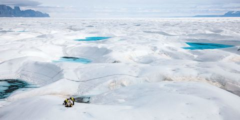 glaciologist jason box, left, at work on the petermann glacier on greenland's northwest coast, which has lost mass at an accelerated pace in recent years box and his family left ohio state for europe a couple years ago, and he is relieved to have escaped america's culture of climate change denial