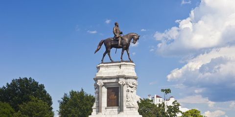 Human, Sky, Sculpture, Horse, Landmark, Working animal, Horse tack, Monument, Bridle, Memorial,