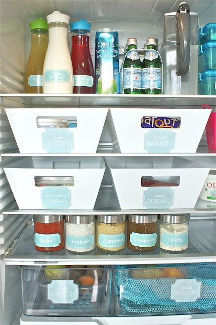 "<p>Because when items have specific homes, less clutter collects. And if you're feeling especially motivated, transfer store-bought foods, like hummus and salsa, into matching labeled jars for easier stacking and identifying.<span></span></p><p><a href=""http://thesocialhome.blogspot.com/2012/09/fancy-fridge-fail.html"" target=""_blank""><em>See more at The Social Home »</em></a></p>"