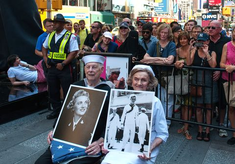 NEW YORK, NY - AUGUST 14: World War II Veterans Ray and Ellie Williams wait to recreate the iconic Alfred Eisenstaedt photograph in Times Square on August 14, 2015 in New York City. The Williams, Navy veterans also celebrating their 70th wedding anniversary, recreated the kiss as part of a ceremony remembering the 70th anniversary of Victory in Japan Day.  (Photo by Bryan Thomas/Getty Images)