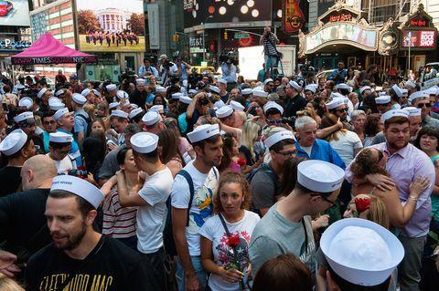 Hair, Face, Crowd, Hat, Public space, Cap, Baseball cap, Public event, Market, Audience,