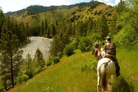 "<p><strong>Where</strong>: The wild, wild west hasn't lost any of its original charm, and Montana's luxe <a href=""http://www.triplecreekranch.com/"" target=""_blank"">Triple Creek Ranch</a> melds timeless vistas and modern amenities. </p><p><strong>Your Game Plan</strong>: Ditch your usual workout in favor of cowboy classics like cattle herding and trail rides. If your significant other isn't down for getting dirty, the spa awaits. And if both of you need to work out the kinks that come with long days in the saddle (or long nights spent getting busy), in-room massages are available.</p>"