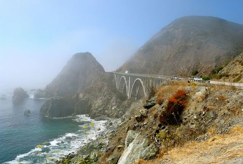 <p><strong>Where:</strong> California, USA</p><p>This stretch of Highway1chases the ragged central California coastline through Big Sur, which runs from San Simeon to Carmel. This drive is renowned for its staggering views over perilous cliffs, revealing the Pacific Ocean's whitecaps as they rush past immense dark rocks. </p><p>During peak traffic hours, lumbering rental cars and motorhomes dampen the pace. If you're stuck in slow motion, we suggest a detour through the nearby but less-traveled Nacimiento-Fergusson Road, which cuts east and offers an amazing bird's-eye view of the coast below.</p>