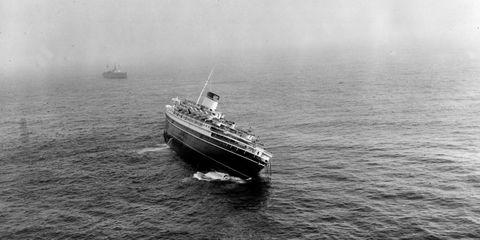 Watercraft, Boat, Water, Liquid, Passenger ship, Ocean liner, Fluid, Waterway, Atmospheric phenomenon, Naval architecture,