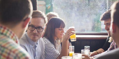 friends drinking in a pub